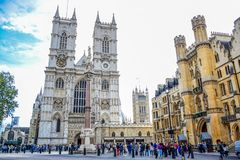 Tourists entering and visiting Westminster Abbey at the west of the Palace of Westminster in London, UK royalty free stock photos