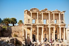 Tourists in Ephesus. Historic library of Julius Celsus in Ephesus, this ancient building is one of the most spectacular buildings in Ephesus, and it is well Royalty Free Stock Image