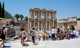 Tourists at Ephesus, Izmir, Turkey. Tourists visiting the ancient city of Ephesus, near Izmir, Turkey. Tourists in front of the library of Celsius Royalty Free Stock Photography