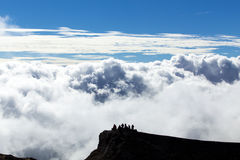 Tourists on Etna mountain Stock Photo