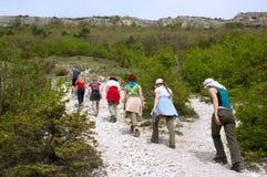 Tourists on excursion in mountains Royalty Free Stock Photo