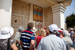 Tourists on an excursion in the Palace of Knossos. Heraklion, Greece Royalty Free Stock Images
