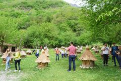 Tourists on excursions in the mountain apiary. Photo on memory