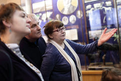 Tourists at the exhibition. Tourists looking at exhibit at the exhibition Royalty Free Stock Photos