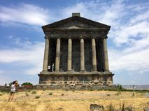 Tourists explore Greco-Roman Temple of Garni in Armenia. Tourists explore the Temple of Garni overlooking Garni Gorge. Reconstructed between 1969 and 1975, the Royalty Free Stock Image