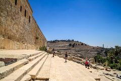 Tourists explore a monumental flight of steps leading up to the second Herodian temple mount, through the Hulda gates with Mount. Tourists explore a monumental royalty free stock photography