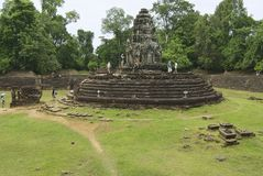 Tourists explore the Neak Pean temple on August 09, 2008 in Angkor, Cambodia. Royalty Free Stock Photos