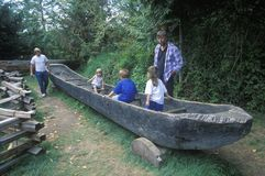Tourists explore replica of dugout canoe Royalty Free Stock Photos