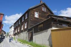 Tourists explore street of Roros in Roros, Norway. Royalty Free Stock Photo