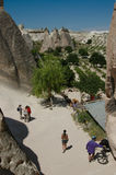 Tourists exploring Cappadocia Sandstone landscape Royalty Free Stock Images