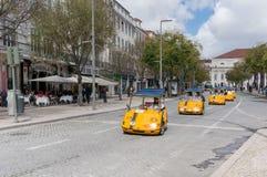 Tourists exploring Lisbon on rented GoCar Royalty Free Stock Photography