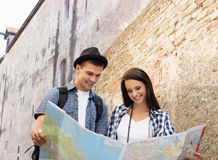 Tourists exploring the map on old baroque street Royalty Free Stock Photography
