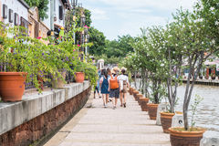 Tourists exploring the street along the river side of the Malacca River. Malacca has been listed as a UNESCO World Heritage Site. Malacca, Malaysia - July 15 Stock Photography