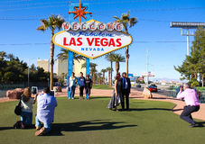 Tourists at the Fabulous Las Vegas sign. Royalty Free Stock Images