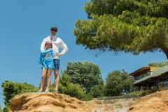 Tourists father and daughter on Aegean coast of Sithonia peninsula Royalty Free Stock Images