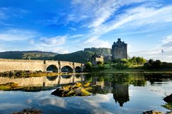 Tourists favourite place in Scotland - Isle of Skye. Very famous castle in Scotland called Eilean Donan castle. Scotland green nat. Ure. Top of the mountains stock photo