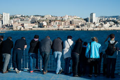 Tourists on a ferry in Marseille. Tourists on a ferry look at the city of Marseille on May 3rd, 2013. European Capital of Culture 2013, Marseille is part of a Royalty Free Stock Image