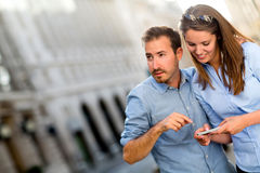 Tourists finding a location on their phone Royalty Free Stock Photography