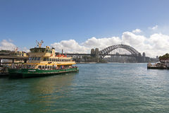Tourists on Fishburn ferry docking at the pier near Sydney Harbo Stock Images