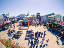 Tourists on Fisherman`s Wharf, Pier 39 at carousel Stock Images
