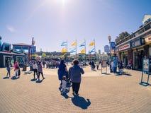 Tourists on Fisherman`s Wharf, Pier 39 in sun light Stock Photo