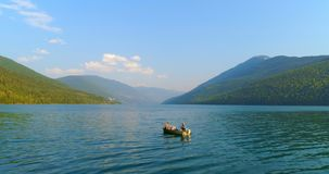 Tourists fishing on a boat 4k. Tourists fishing on a boat in the river 4k stock footage
