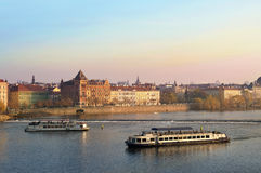 Tourists float on a boats on the Vltava river Royalty Free Stock Photos