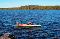 Tourists float on a canoe Royalty Free Stock Photo