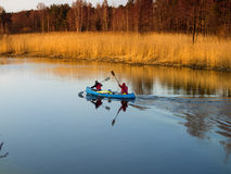 Tourists floating on the river Kovash Leningrad region by kayak Royalty Free Stock Images