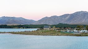 TOURISTS FLOCK TO PHOTOGRAPH THE BEAUTY OF THE CHURCH OF THE GOOD SHEPHERD ON LAKE TEKAPO, NEW ZEALAND stock images
