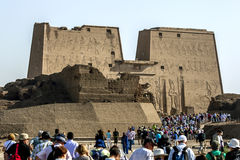 Tourists flock towards the Temple of Horus in Edfu, Egypt. Royalty Free Stock Photography