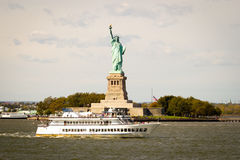 Tourists flocking to the Statue of Liberty, New Yo. Boats of tourists going to Liberty Island to see the Statue of Liberty on the East and Hudson Rivers in lower Royalty Free Stock Photos