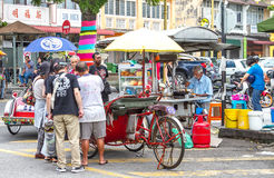 Tourists flocking to street vendor in Penang Royalty Free Stock Photo