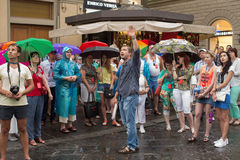 Tourists in Florence. Florence, Italy-June 11, 2015. Tour leader giving a talk about the famous Il Duomo Cathedral to a group of tourists in the Piazza del stock image