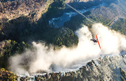 Tourists fly over the Victoria Falls on the trikes. Royalty Free Stock Images
