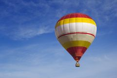Aerostatic baloon closeup. Tourists flying above the sky in aerostatic baloon over beautiful cloudy blue sky Stock Image