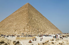 Tourists at the foot of an Egyptian pyramid Stock Photo