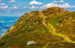 Tourists footpath over the hill top Royalty Free Stock Photo
