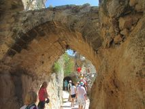 Tourists in the fortress of the King of the Crusaders Richard the Lionheart, the mountains of northern Cyprus. Arch preserved 800 stock photo
