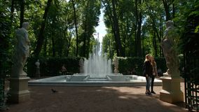 Tourists and the fountain and antique statues and the Summer Garden Royalty Free Stock Photography