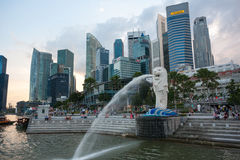 Tourists at the fountain of the Merlion in Singapore Stock Images