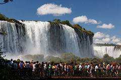 Tourists in Foz do Iguassu Park. Tourists having a close encounter with the powerful waterfalls in the Iguassu Park Stock Images