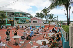 Tourists at freeport. Many tourists seated at bars of port lucaya at freeport (bahamas Royalty Free Stock Photos