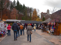 Tourists in front of Bran Castle Royalty Free Stock Image