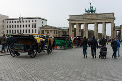 Tourists in front of the Brandenburg Gate. Royalty Free Stock Photo