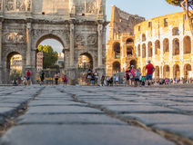 Tourists in front of the Colosseum in Rome Stock Photography