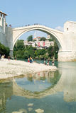 Tourists in front of the famous bridge at Mostar Stock Image