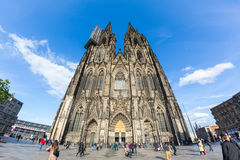 Tourists in front of gothic Cathedral of the city. Stock Photos