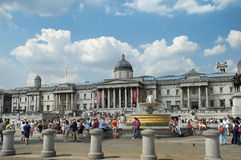 Tourists in front of the National Gallery on Trafalgar Square in London Royalty Free Stock Photo