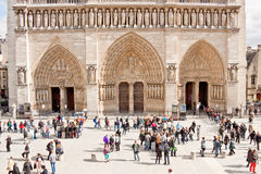 Tourists in front of Notre Dame de Paris cathedral. Royalty Free Stock Photos